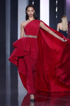 Deep raspberry silk crêpe bustle gown with draped sash.