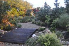 Minimalistic wooden bridge over a dry stream bed