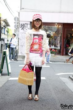 Taken from@TokyoFashion: This cute girl is Nakayama, a 15-year-old girl who's still in high school. Her outfit includes a short chiffon ruffled skirt, a top featuring a picture of old-style telephones and a crochet bolero that's a Zara remake. She's also wearing black tights and brown oxford shoes that she bought at a Shimokitazawa area resale shop.