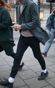 nude turtleneck + grey blazer + black trousers
