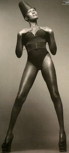Grace Jones (with legs that go on for miles 'n miles).  Signed to Island Records in '77, hits include 'Slave to the Rhythm' and 'Private Life'.  Grace was also a muse to Andy Warhol, who photographed her extensively. #music #models
