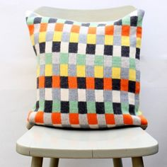 Beautiful and bold! How gorge is the Gabrielle Vary Plato cushion with its orange, yellow, green, black and grey geometric squares?!