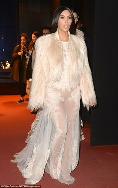 Sexy! The eldest Kardashian's frock was nearly completely sheer and didn't leave much to the imagination