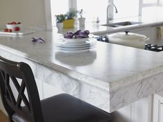 You could have a bar just like this in your kitchen! Formica® Laminate 6696 Carrara Bianco looks great on any kitchen bar. Marble Countertops Bathroom, Carrara Marble Kitchen, Countertop Redo, Formica Countertops, Kitchen Cabinet Remodel, Kitchen Redo, New Kitchen, Kitchen Ideas, Kitchen Chairs