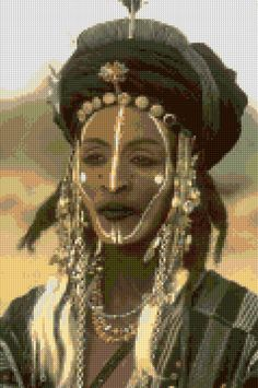 A personal favorite from my Etsy shop https://www.etsy.com/listing/274027558/cross-stitch-wodaabe-man-tribal-beauty