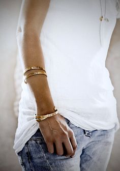 white tee, denim, gold bangles & cuffs #style #fashion #jewelry