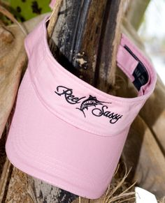 """REEL SASSY VISOR     Product Description:           Velcro closure for a perfect fit. 100% cotton twill. Don't be caught uncovered – buy a """"Reel Sassy"""" visor today! Embroidered with the """"Reel Sassy"""" logo. Pink embroidery on black and black embroidery on pink.    $17.95  www.reelsassy.com"""