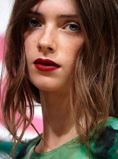 Showcasing the vibrant red lip backstage at the Burberry Spring/Summer 2015 show