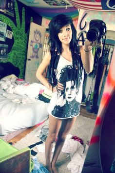 OMG ! she is so pretty ! & her shirt rocks...... & so does her room!  lol!