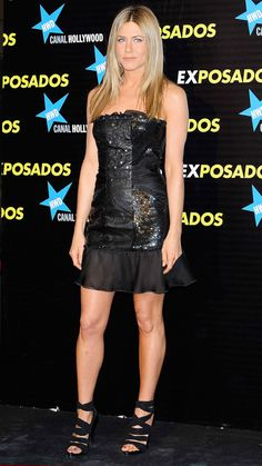 Jennifer Aniston attended the Madrid premiere of The Bounty Hunter in a sequined chiffon Valentino dress with a flouncy hem and wrap sandals.