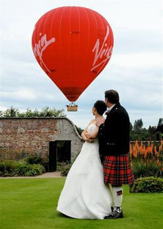 Sheer coincidence that the tartan on the kilt matches the Virgin hot air balloon? A very romantic way to take in the beautiful Scottish landscape on your special day!