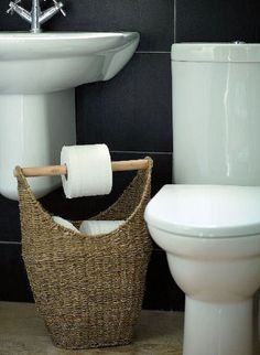 Wicker basket toilet paper storage.