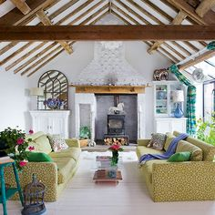 White living room with green furnishings