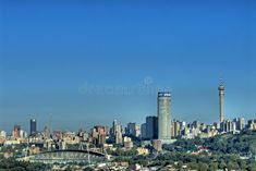 Photo about Scenic view of Johannesburg City skyline with sport stadium in foreground. Image of angle, metropolis, skyscrapers - 4688479 Johannesburg Skyline, Textured Background, South Africa, Landscape Photography, New York Skyline, Skyscraper, Cities, Sport, Pictures