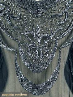 SILVER ON BLACK BEADED FLAPPER DRESS, 1920s Black silk georgette w/ asymmetrical hemline & crystal bugle beading. Detaile