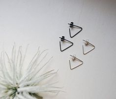 This listing is for one pair of handmade triangle earrings. Je can pick either an silver or oxidized finish. The little triangles will hang