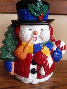 "Candy Cane Snowman Cookie Jar 1991 Service Merchandise, by MyFriendsAttic; $22 USD + $16 US ship. Jolly Snowman cookie jar offered by Service Merchandise  department store in 1991. Measures 10.5"" tall and is about 10"" wide. Comes w/ original box."