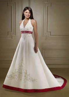 Very elegant halterneck dress with a red belt.