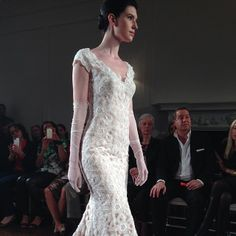 Intricate lace razor-cut gown at Peter Langner...so unique!