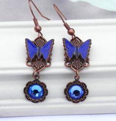 Vintage blue butterflys are set on copper filigree and feature Capri swarovski crystals. Vintage Butterfly, Blue Butterfly, Butterfly Earrings, Keepsake Boxes, Filigree, Vintage Inspired, Dangle Earrings, Swarovski Crystals, Dark Blue