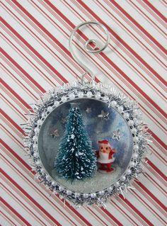 Christmas ornament: miniature snow scene inside a tin.