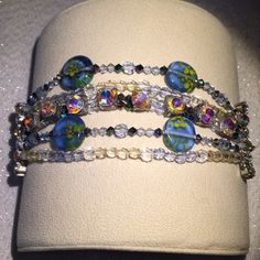 """5 Row Crystal & Rhinestone Multi-Colored Bracelet 5 Row Crystal & Rhinestone Multi-Colored Antiqued Bracelet. Measures almost 7.5"""". Cool toggle closure. Gorgeous! There is just a little bit of the string showing near the closure, but no one is likely to notice. This is a head turner. Jewelry Bracelets"""