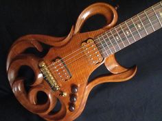 hand carved guitar | ... of the Beautiful Phoenix Hand Carved Electric Guitar By Rigaud Guitars