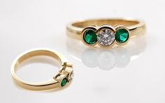 Three stone Bezel set ring with Diamond and Emeralds