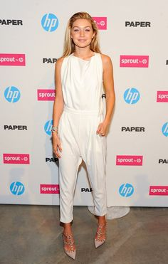 Make a statement like it-girl Gigi Hadid in a silky white jumpsuit and studded heels