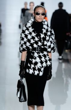 If a houndstooth coat similar to the one from Michael Kors fall 2013 collection seems too overwhelming, Rothman suggests a houndstooth accessory such as a purse or large scarf.