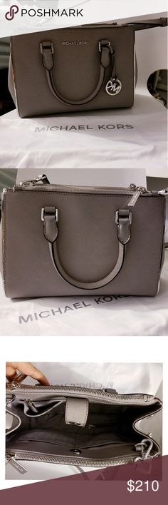 Michael Kors Handbag Brand New Bag , Used only twice & brings dust bag .  Architecturally driven with its artfully curved shape, this Sutton small satchel  from Michael Kors will lend a sculptural edge to your on- and off-duty sets  alike. Meticulously structured from saHiano cow-skin leather and brought to  life with contrast piped edges, this carryall will accentuate any style blueprint  with effortless versatility. Michael Kors Bags