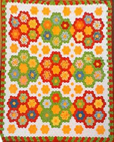 Hexagons...like the unusual color combination for this Grandmother's Flower Garden