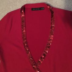 Red with red sequins! Stunning! One of my favorites! Wore this for Christmas & Valentines Day more than once. Love it. BUT now it reminds me of my old BF and I can't bring myself to war it w my new one! Super soft and super sexy! Arm cuffs match waist trim. 74% cotton, 23% nylon & 3% spandex. Great top. Timeless. Goes well with anything from jeans to a long black velvet skirt. The Limited Tops