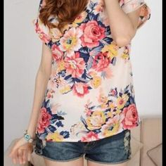Chiffon Colorful Floral Top NWT. Tops run one size smaller than tag size. Vibrant colors and fun floral design will make any outfit pop! Tops