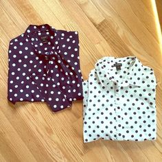 """J Crew polka dot shirt bundle One, a J Crew collared shirt buttons 3/4 of the way down the front. It has white, stitched polka dots and blue polka dots. Measurements 15"""" shoulder; 17"""" chest; length 24"""". Material 100% cotton.    Two, a short sleeve JCREW blouse is navy blue with white polka dots. It has a hook and eye closure on the neck with a tie detail. Measurements: shoulder 15""""; bust 17"""", length 24"""". J. Crew Tops"""