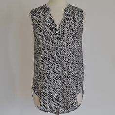 H&M Print Tank Print Tank in Navy/White by H&M. Fabric: 100% Polyester. Gently used with no notable signs of wear. Size 2. Retail - $29.99. H&M Tops Tank Tops
