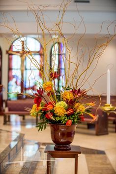 Fall wedding alter arrangement ... The curly willow creates such a graceful line. by Andrea Layne Floral Design (www.andrealaynefloraldesign.com)