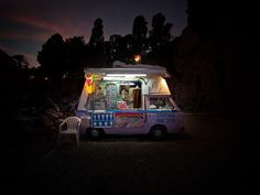 The lighting is superb.  It's like a gleaming light of deliciousness amidst the darkness!  Ice Cream Vendor, Greece.  Photograph by Lior Patel.  Rodos, Greece.