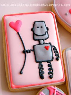Eik! Thinking about Valentines 2013 already. Fantastic robot cookies by 'occasionalcookies.blogspot.ca'.