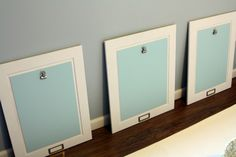 Art Display with repurposed cabinet doors for kids to take pride in their work and change it frequently