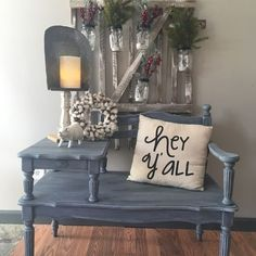 Gossip bench... painted dark grey with aqua peaking through. Sealed with white wax to give it a weathered look. Perfect for entryway, bathroom, bedroom... lots