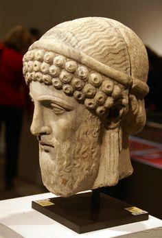 Head of Dionysos, marble, Roman archaistic, circa 2nd Century A.D