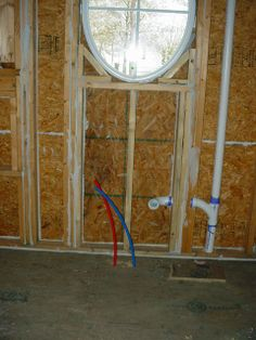 kitchen sink pex plumbing & drain, check out the caulk work sealing all the possible air gaps around the framing and sheathing. nice! (photo)