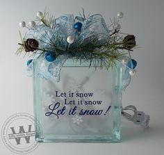 Lighted Glass Block w/Vinyl Lettering - Let It Snow A beautiful glass block illuminated with a string of 20 white lights. Comes decorated with Decorative Glass Blocks, Lighted Glass Blocks, Glass Cube, Glass Boxes, Christmas Glass Blocks, Christmas Wood, Christmas Signs, Christmas Ideas, Dremel
