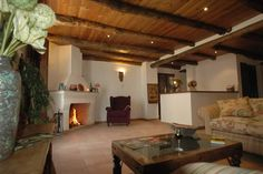 Relax in the cosy sitting room at Posada San Marcos