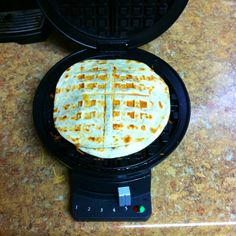 Waffle Iron= quesadilla maker :). I am so going to have to try this!