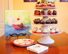 I do like cupcakes... but this tower of cake plates is amazing! :)