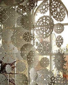 paper snowflakes strung together and hung in front of a window; would be great to do with kids