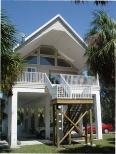 Hurricane proof two story stilt house design built in the for Hurricane proof beach house plans