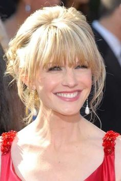 Kathryn Morris is showing off another famous messy updo hairstyle at the Emmy Awards. Description from celebsalon.sheknows.com. I searched for this on bing.com/images